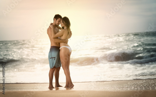 Beautiful girls kissing on beach
