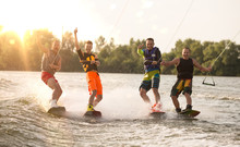 Four Wake Bord Riders Having Fun