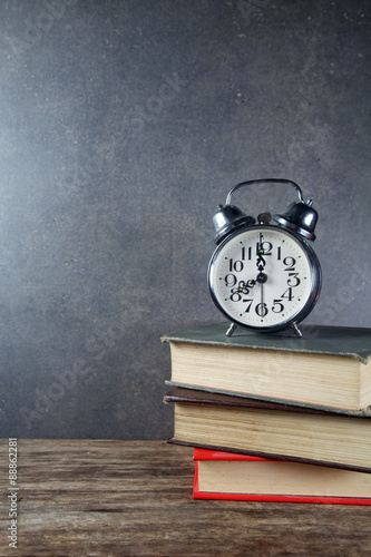 Deurstickers Retro Back to school background with books and alarm clock