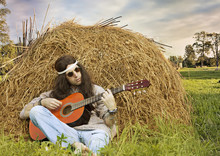 Hippie Man Playing Guitar Outd...