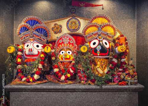 Fotografie, Obraz  Jagannath idol with his elder brother Balabhadra and sister Subhadra, in Hindu Temple