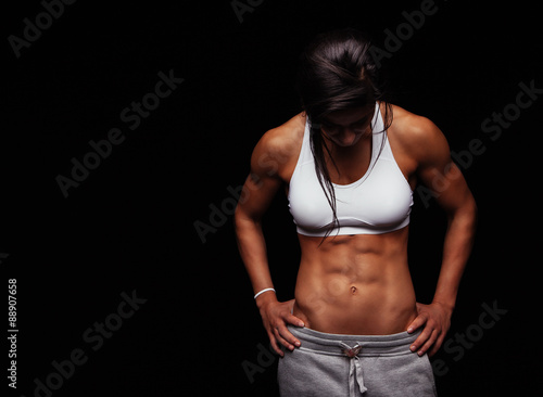 Female athlete with muscular abs Canvas Print