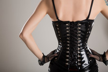 Rear View Of Sexy Fetish Woman In Black Corset