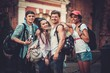canvas print picture - Multiracial friends tourists making selfie in an old city