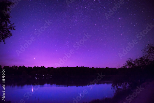 Spoed Foto op Canvas Violet Beautiful night sky with many stars on a lake