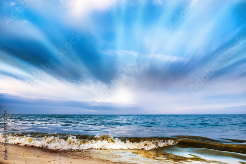 Poster Molens Tropical beach and blue sea with waves
