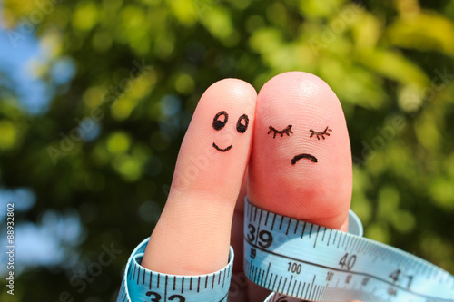 Obraz Finger art of couple with meter. The concept man is thin, woman is fat. - fototapety do salonu