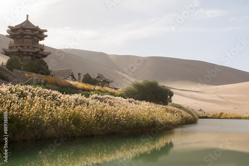 Tuinposter China Chinese pavilion near Crescent Moon Lake in desert, Dunhuang, Ch