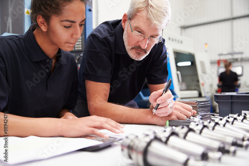 Fotografiet  Engineer And Apprentice Planning CNC Machinery Project