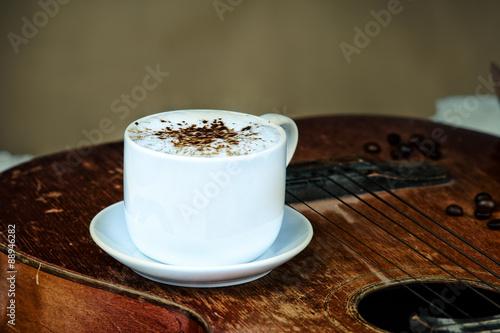 Foto op Plexiglas Chocolade Coffee cup, coffee beans and guitar
