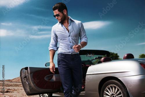 Fotografija  Handsome man near the car. Luxury life.