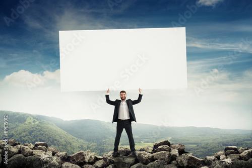 Fotografía  man holding big empty placard