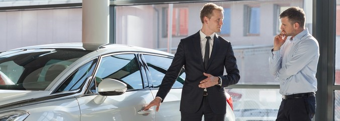 Car dealer selling expensive car