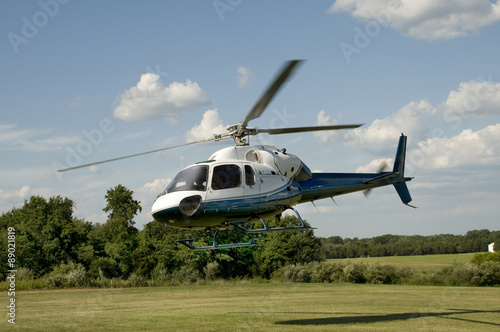 Fotografie, Obraz  Helicopter taking off or landing in a field