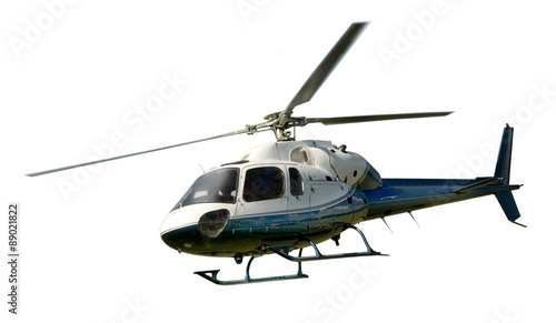 Helicopter in flight isolated against white