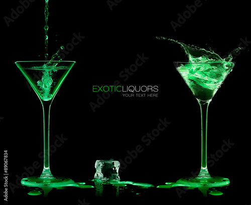 Fotografia Two Cocktail Glasses with Green Liquor. Style and Celebration Co