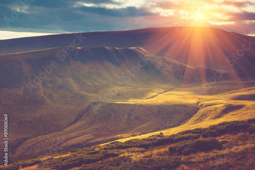 Photo Stands Eggplant Scenic view of mountains, autumn landscape with colorful hills at sunset.