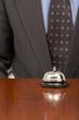 hotel bell at reception desk