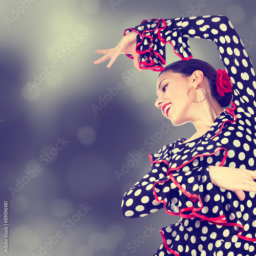 Plagát  Close-up portrait of a young woman dancing flamenco on abstract background
