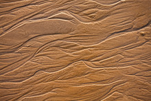 The Texture Of Wet Sea Sand