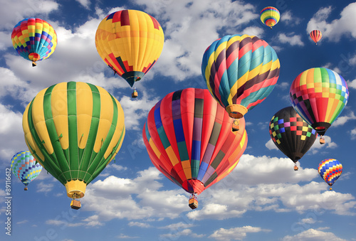 Fotobehang Ballon Multicolored hot air balloons flying