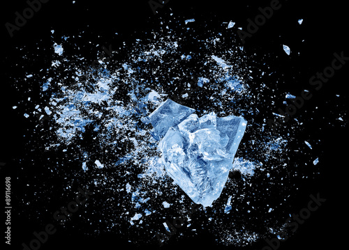 Fotografie, Obraz  Abstract blue Ice crash explosion parts on black background