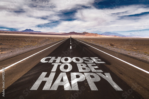Photo  Choose To Be Happy written on desert road