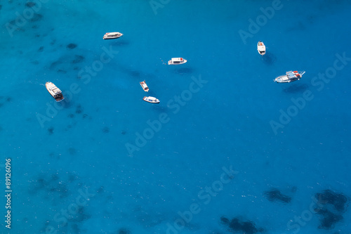 Boats Anchored in a Sea Bay with Turquoise Water