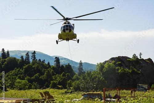 Staande foto Helicopter Passenger transport cargo helicopter flies