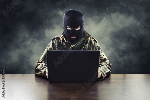 Photo  Masked cyber terrorist in military uniform hacking army intelligence