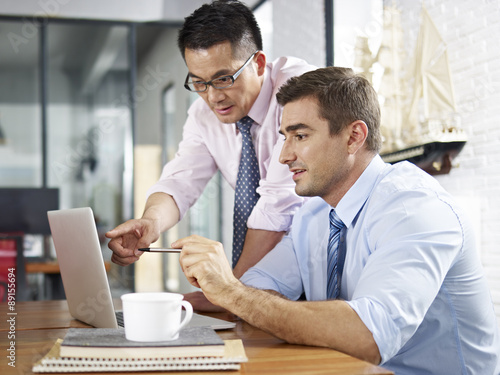 Businessmen working together in office Canvas Print