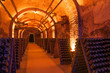 canvas print picture - Rows of dusty champagne bottles in Reims cellar, France