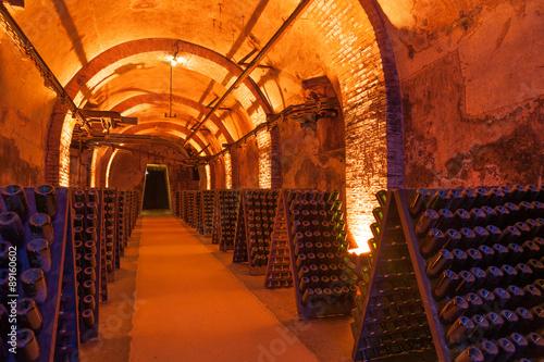 Fotografie, Obraz  Rows of dusty champagne bottles in Reims cellar, France