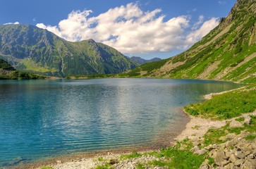 Summer mountain landscape. Lake in mountains. Morskie Oko (Sea Eye) Lake is the most popular place in High Tatra Mountains, Poland.