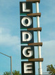 aged and worn vintage photo of neon lodge sign
