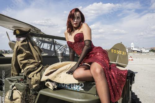 pinup dressed in era of the Second World War, beauty redheaded w Fototapeta