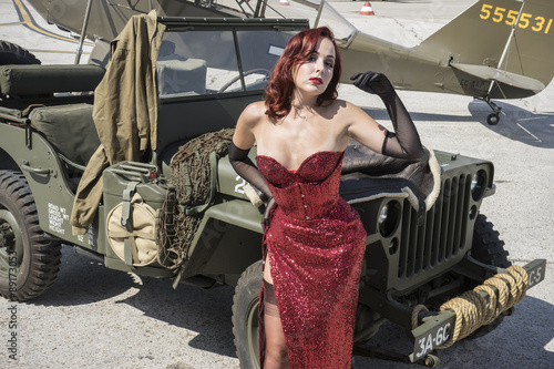Fototapeta Wwii, pinup dressed in era of the Second World War on a military