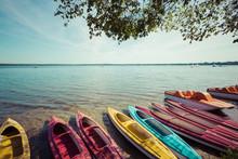 Colorful Kayaks Moored On Lake...