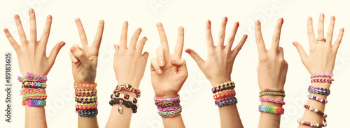 Photo People's hands with braceles on light background