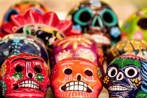 Fotografering  Brightly painted sugar skulls