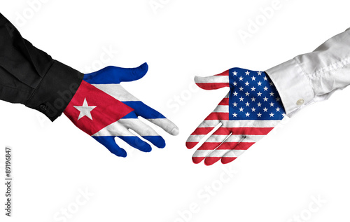 Cuban and American leaders shaking hands on a deal agreement Wallpaper Mural