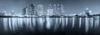 Panorama of Benjakiti park city downtown skyline at night with w