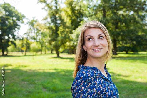 Fotografie, Obraz  young woman in the park looking left to space
