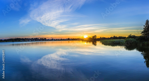 sunset in Zinnowitz with reflection of the backwater Canvas Print