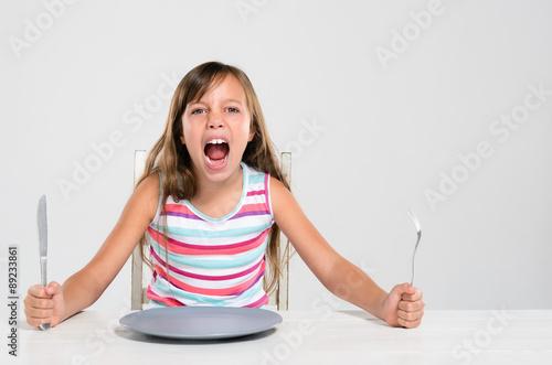 Fotografiet  Rude screaming child at dinner