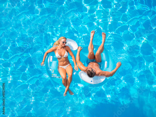 Couple Outside Relaxing In Swimming Pool Canvas Print