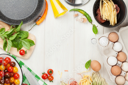 Foto op Canvas Koken Pasta cooking ingredients and utensils