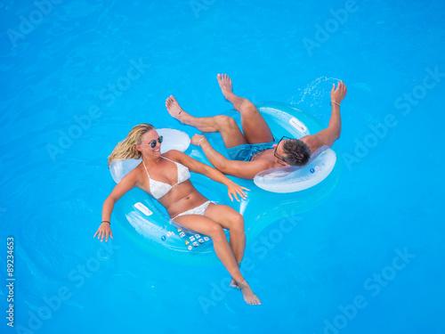 Fototapeta  Couple Outside Relaxing In Swimming Pool