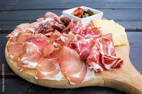 Canvas Print typical Italian appetizer with salami, cheese and pickles