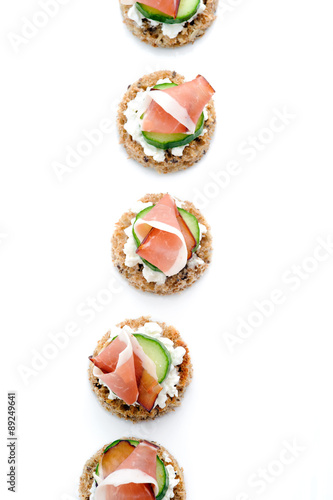 Tuinposter Voorgerecht Platter of ham appetisers